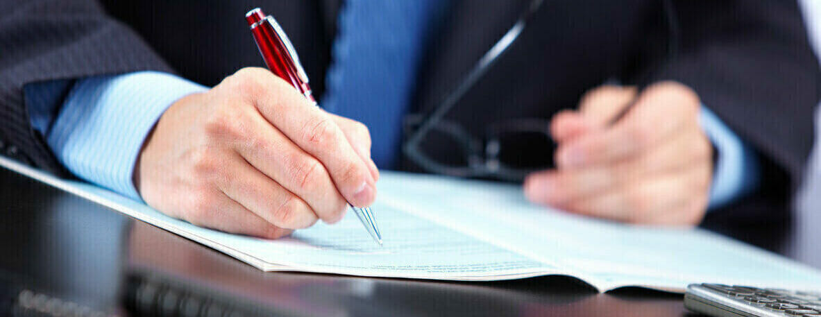 Person writing a document